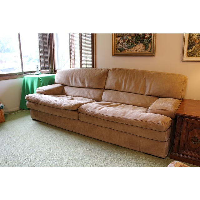 Roche-bobois Paris IL Teatro straight arm sofa. 3 cushions covered in taupe buffalo leather . Feather/down filled for...