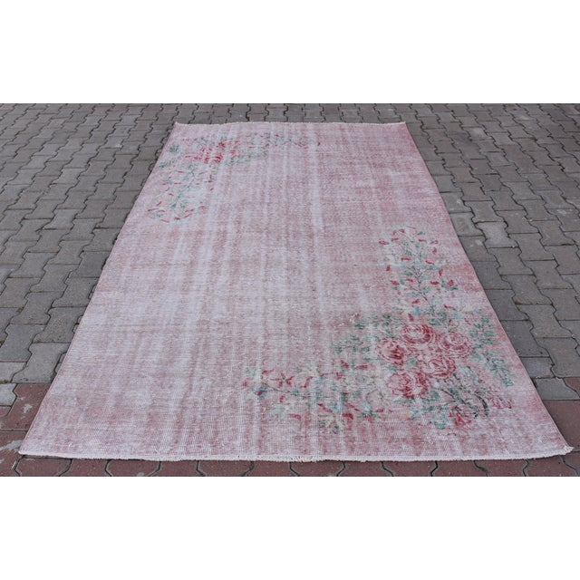 Offering a Turkish Boho Chic Tribal Handwoven Distressed vintage rare wool area rug Unique design in pink. Made with 100%...