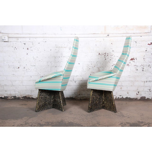 A rare and outstanding pair of mid-century modern Brutalist lounge chairs designed by Adrian Pearsall. The chairs feature...