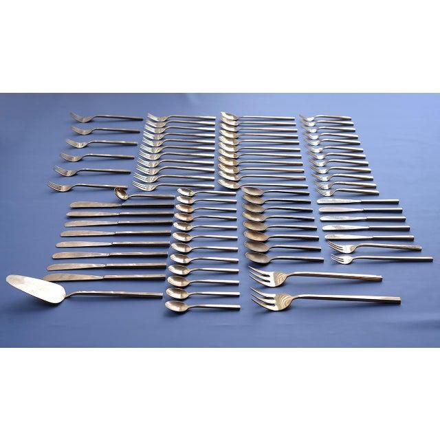 "Large set of vintage Danish ""Scanline"" bronze flatware consisting of 79 pieces designed by Sigvard Bernadotte. Set..."
