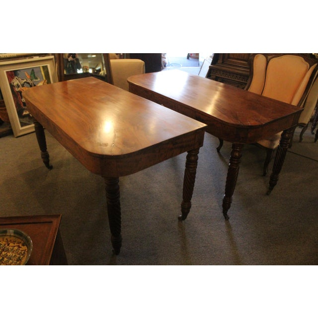 Pair of mahogany art nouveau console tables that link together to create one larger table. Made in the early 20th century.