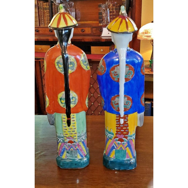 Presenting a lovely vintage pair of Chinese ceramic noblemen. 20th century, circa 1960-1980. One nobleman or Courteneer...