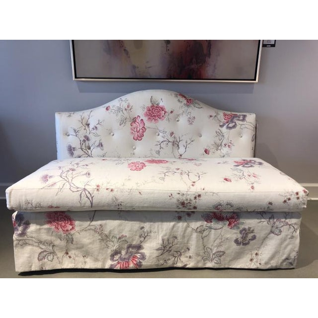 The Patti Skirted Settee is a first quality showroom sample that features a White & Rose patterned fabric (20565-72) with...