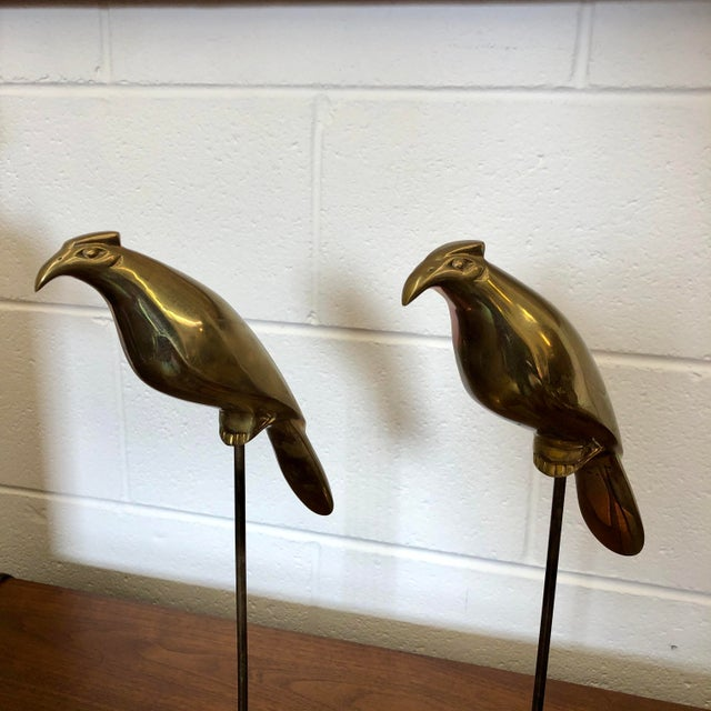 Unusual pair of vintage bird figures on perch stands in brass.