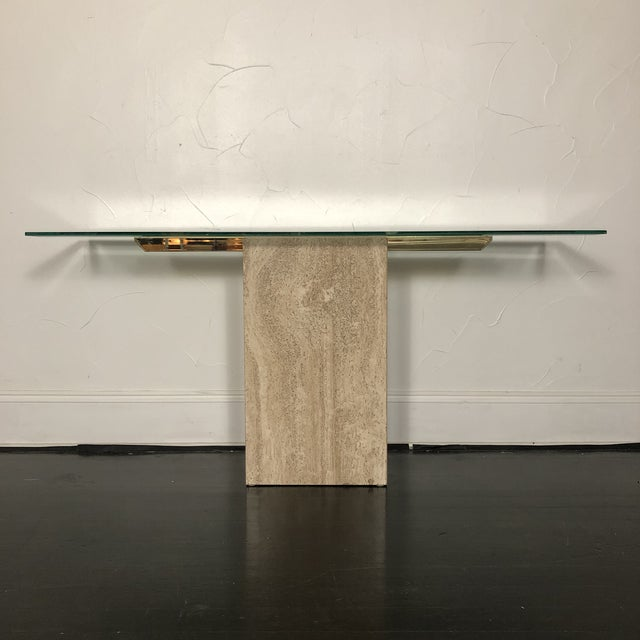 Elegant Italian Marble / Brass Console Table by Artedi. Lovely and sleek Italian Marble Base with inlaid Brass under thick...