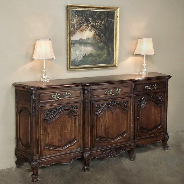 Antique Country French Louis XV Step-Front Buffet is a wonderful example of hand-crafted excellence, rendered from solid...