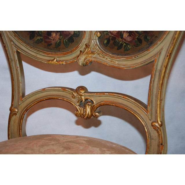 circa 1870 A fine pair of Louis XV style painted and gilded French boudoir chairs, circa 1870. The chairs have the...