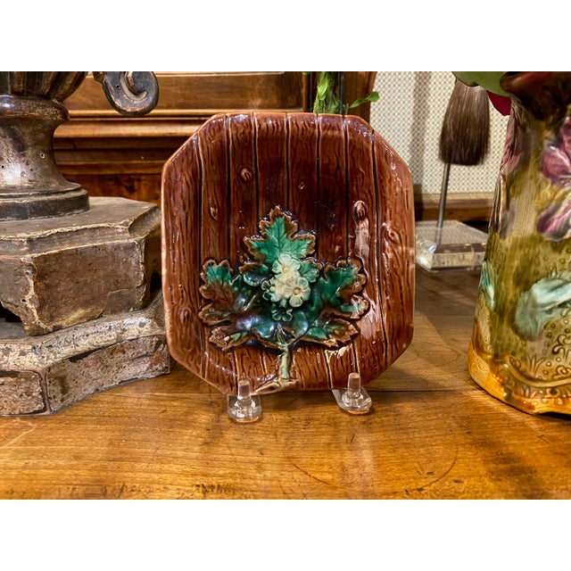 A brown French majolica dish with a green leaf and yellow and green flowers. A great catchall for earrings, small rings or...