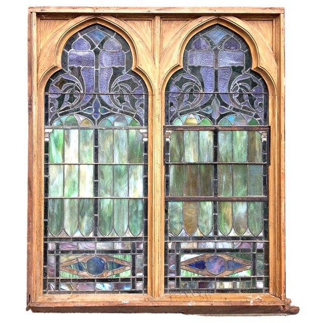 Late 19th century leaded polychrome, multicolored stained glass windows of cusped arch form having geometric and foliate...