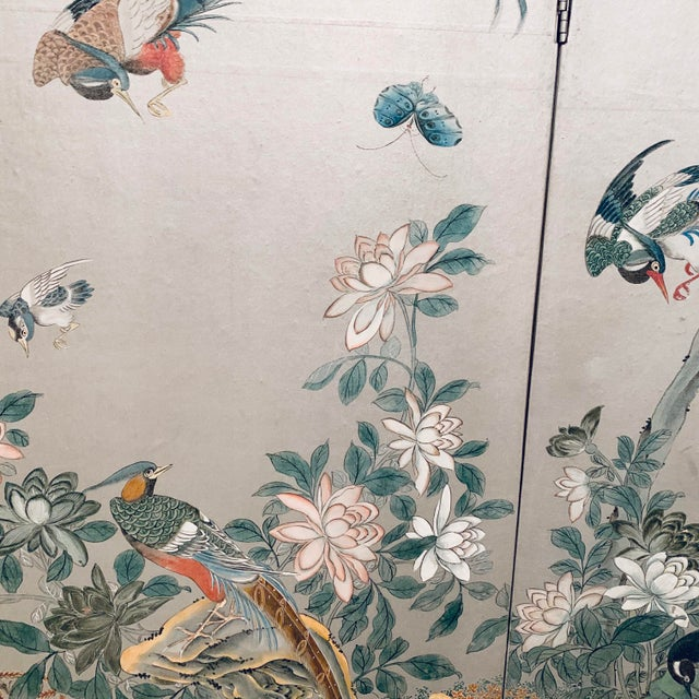 Three panel Chinoiserie room divider/decorative screen. Exquisitely hand-painted on silver hand-painted paper, and...