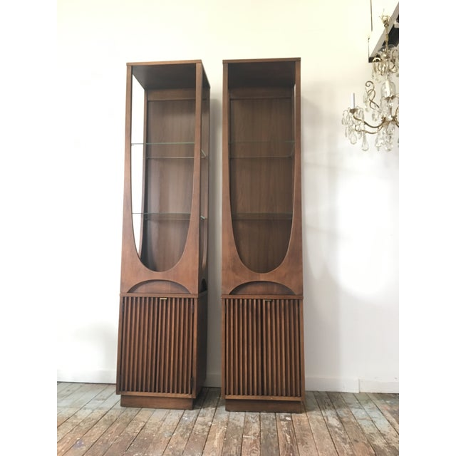 A seemingly rare pair of Broyhill Brasilia Display Cabinets. According to a former Broyhill employee who worked there in...