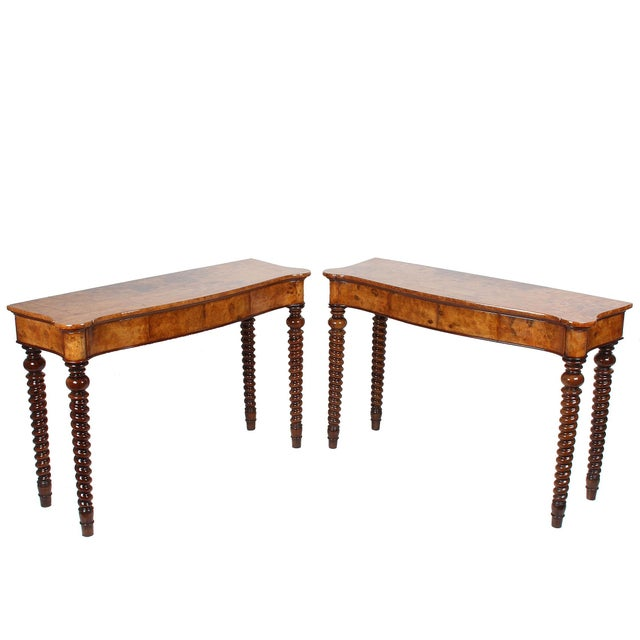 Attractive pair of 19th century French Baroque shaped-top console tables with birch burlwood and delicate inlay...