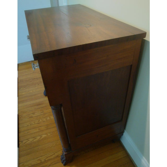 Fancy antique tall dresser in walnut with lots of storage in drawers of graduated sizes. Elaborate styling with burl maple...