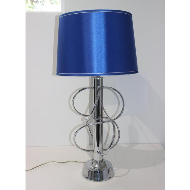 "This stylish Scolari inspired polished chrome table lamp dates to the 1970s. Note: Height to top of socket 25"". Note:..."
