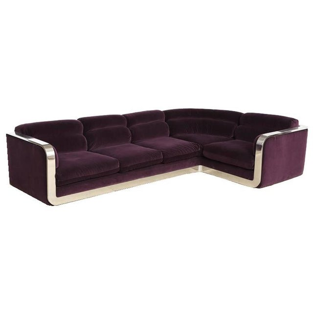Corner sofa by Maxform, circa 1960s. The sofa, imprinted with the Maxform logo, has been reupholstered in a dark purple...