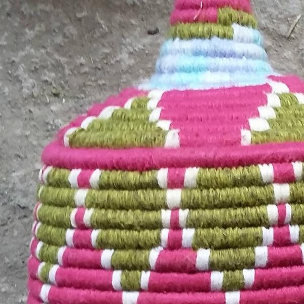 Beautiful Moroccan Berber basket is hand-woven with wool and straw by local artisans in Morocco. Traditionally used by...