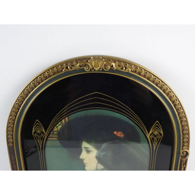 Antique art nouveau style carved round top frame. Comes with print of young and old women under reverse painted glass....