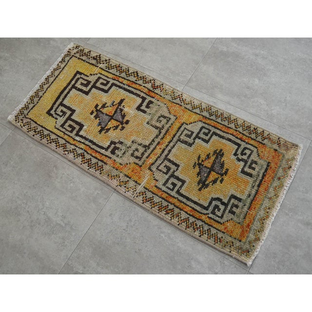Antique orange - yellow background color yastik rug perfect for a small guest bath or in front of the kitchen sink...