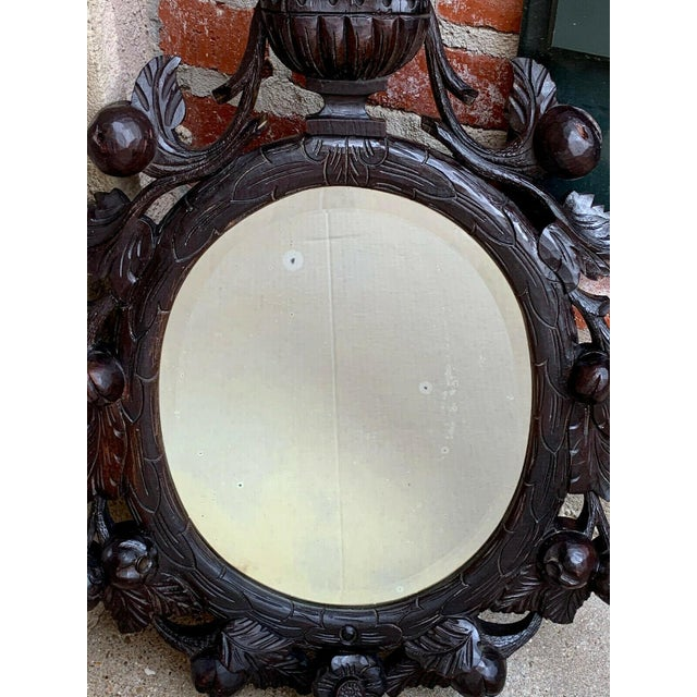 19th Century Antique English Black Forest Style Carved Dark Oak Oval Wall Mirror For Sale - Image 11 of 13