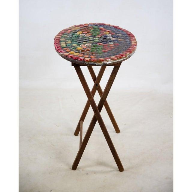 1970s Folk Art Bottle Cap X Frame Side Table | Chairish