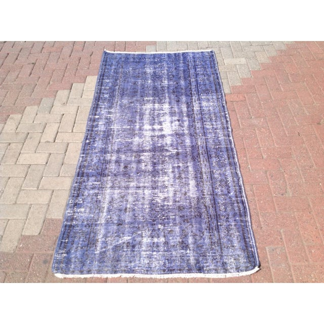 Hand woven Anatolian rug neutralized from its original colors, this rug is overdyed in a spectrum of modern hues that...