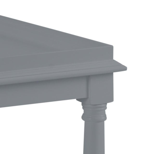 This acacia wood side table features a single shelf and turned legs. The color is Benjamin Moore Dior Gray with a semi-...