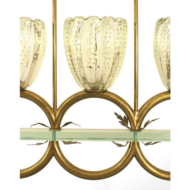 Italian 1940 chandelier with three large fluted clear glass shades supported by three consecutive brass ring arms...