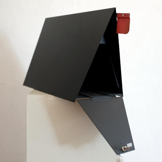 A-frame metal mailbox by Babco. Produced in the 1950s in Los Angeles California. It includes a retractable red flag to...