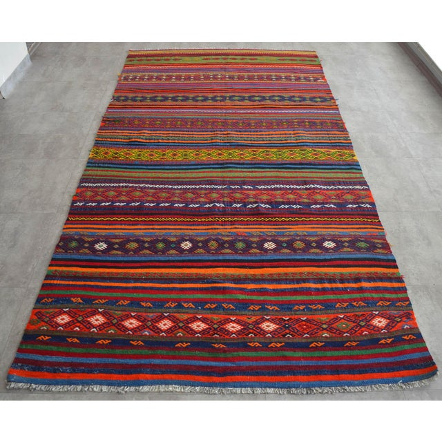 A Vintage Turkish Kilim handwoven wool Jajim rug made of hand spun wool on wool hair and natural dyes. The condition is...
