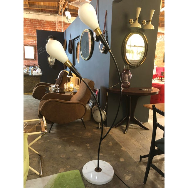 Midcentury Italian two-armed arc floor lamp, 1970s. Brass riser and white round marble base. Very decorative lamp.