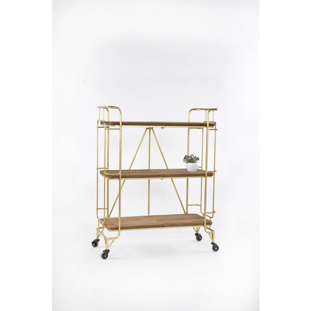 """Measurements: 32.5""""l x 13.75""""d x 40.25""""h, 28lbs Between shelf: 12.5"""" Materials: Metal, wood Color: Gold and brown Some..."""