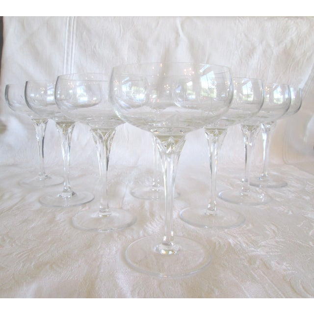 "Glamorous set of eight crystal cocktail coupes with delicate etched bowls in Gorham's ""Jolie"" pattern."
