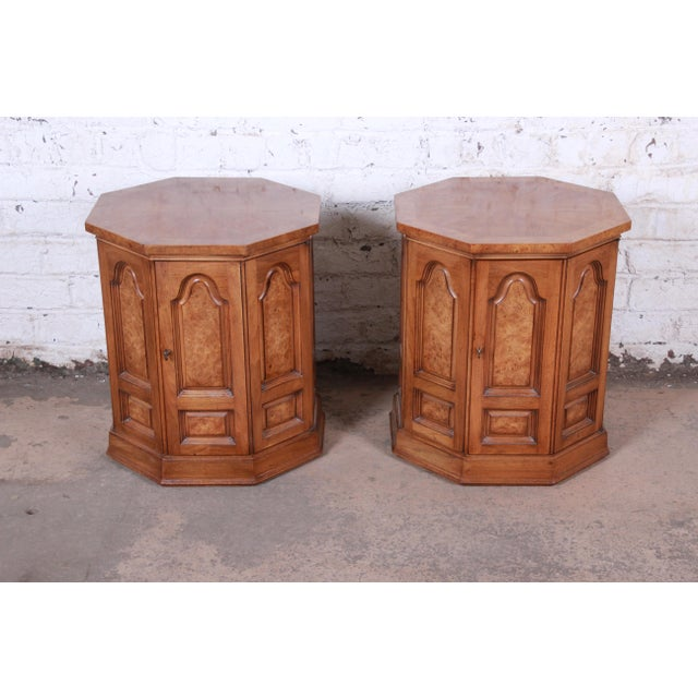 A gorgeous pair of mid-century modern Hollywood Regency side table cabinets or nightstands By Mastercraft Furniture USA,...