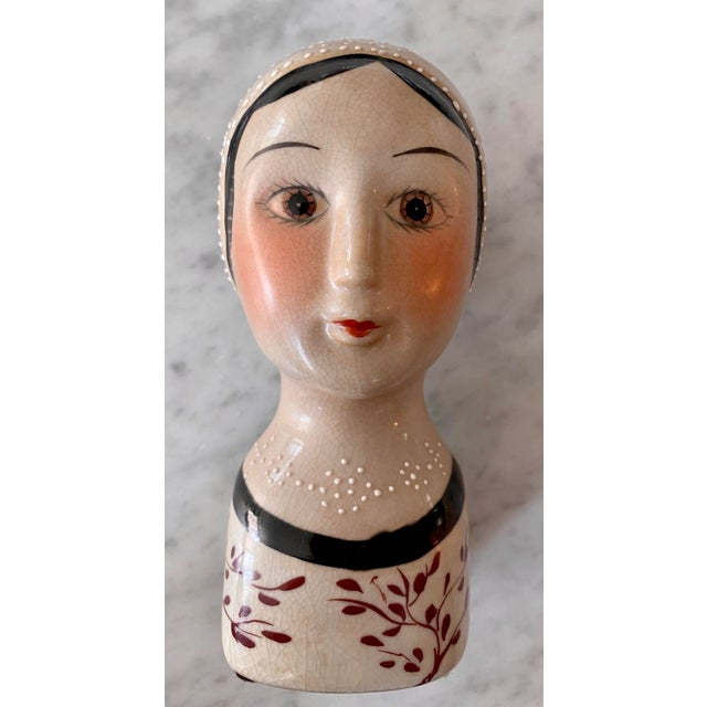 Vintage Porcelain 1920's Flapper Girl figurine. This dashing darling is hand painted with the beaded detailing of a multi-...