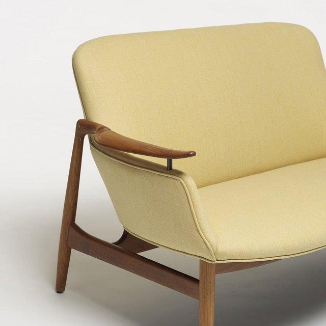 Finn Juhl Settee for Niels Vodder. Teak framed settee and upholstered in fabric.