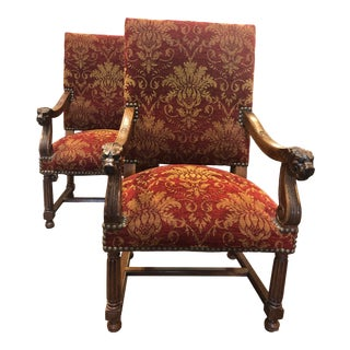 Mid 20th Century English Arm Chairs in Burgundy & Gold Upholstery With Wooden Carved Lions Head Arms and Carved Wood Base With Nailhead Trim - a Pair For Sale