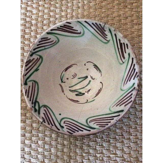 Beautiful, hand-painted strokes of aubergine and green adorn this Spanish delightfully graphic deep bowl. Great on a wall...