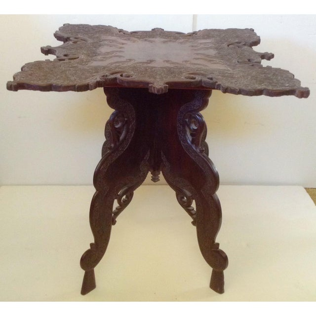 Beautiful 1920's hand carved side table from Kashmir. The legs fit into groves under the table and the whole thing can be...