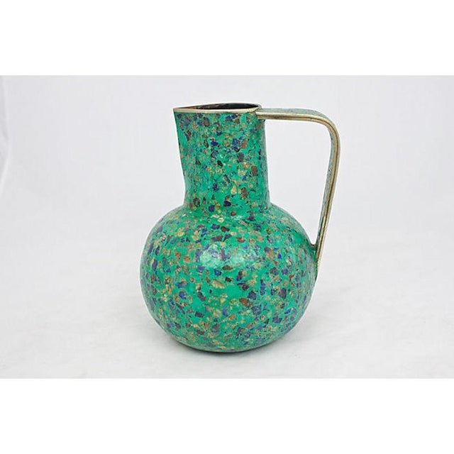 1950's hand-crafted Taxco pitcher with malachite and lapis lazuli inlay motif. Styled in the manor of Pepe Mendoza. No...
