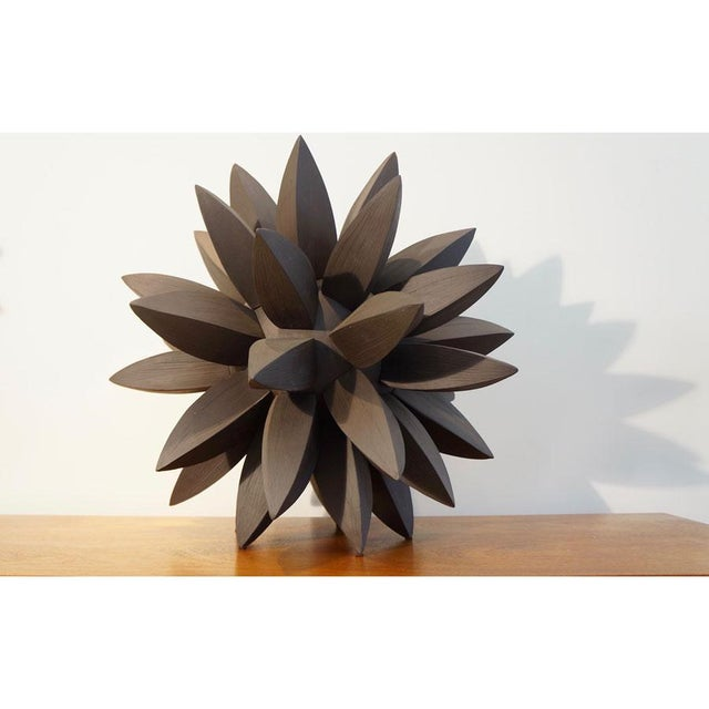 This listing is for an ebony star sculpture. Artist: Titia Estes Clay: Black Stoneware Clay Glaze: None