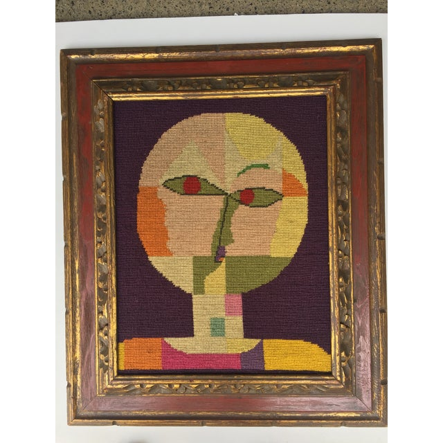 Great original needlepoint after Paul Klee. 14 x 18 Overall size with mid-century carved frame is 21.25 x 25.25.