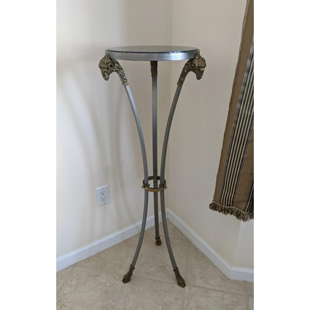 Vintage Maison Jansen style tall pedestal table with black marble top and Ram's head accents. Tri-foot base finished in...