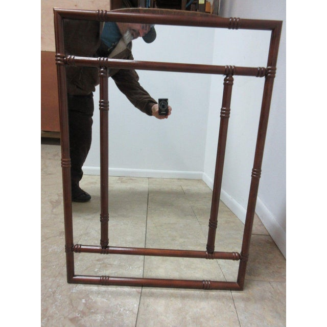 A Bombay company mahogany mirror. Nice shape. tight and sturdy.. minor wear Please see our photos as they are considered...