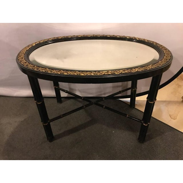 Mid 20th Century Hollywood Regency Beveled Mirror Top Black Oval Coffee Table With Bronze Mounts For Sale - Image 5 of 9