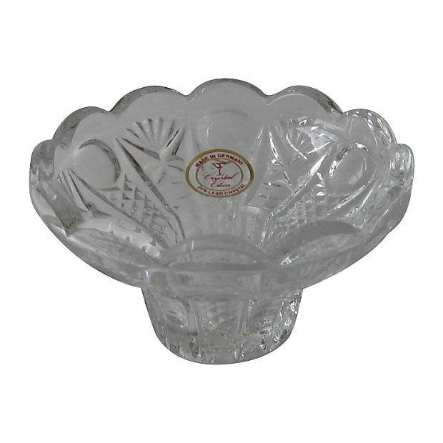 Set of three European vintage lead crystal taper holders. Lovely as part of a table centerpiece or combined with other...