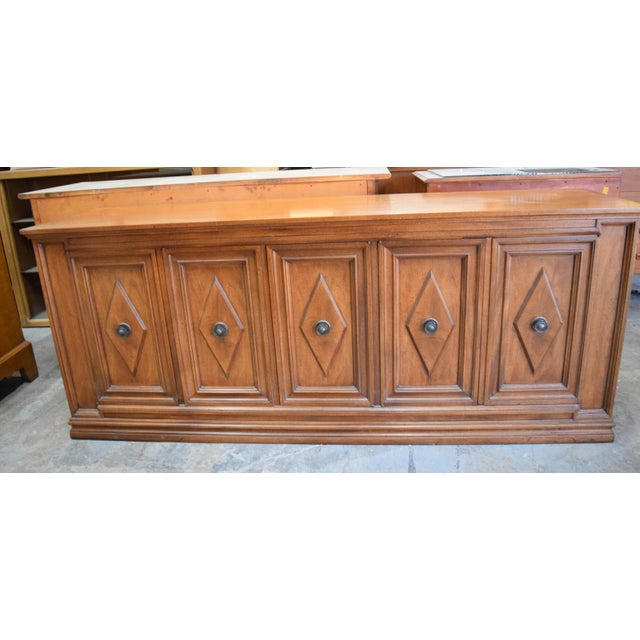 Solid wood sideboard with five doors and three drawers. Sold as is. It has some light scratches.