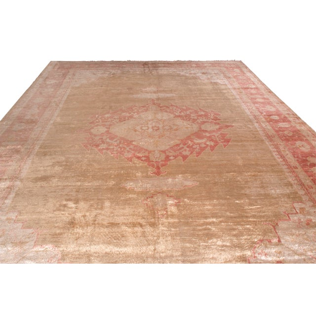 Hand knotted in notoriously sheen angora wool originating from Turkey between 1900-1910, this antique rug connotes an...