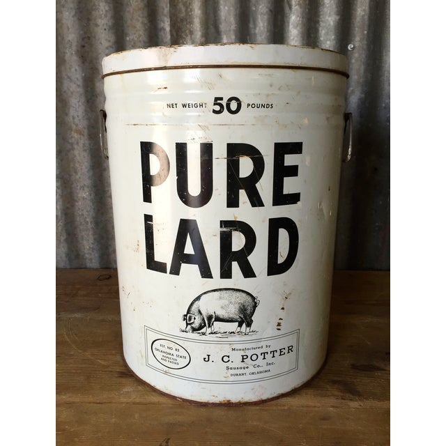 """Absolutely amazing white metal container with the perfect black pig. Reads """"Pure Lard net wt. 50lbs; J.C. Potter Sausage..."""