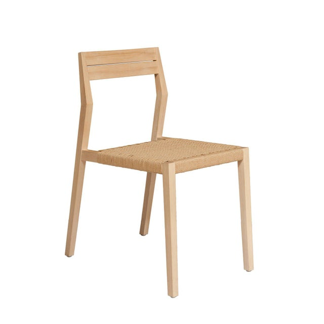 "Solid white oak dining chair with paper cord Seat. Designed by Paul Mignogna for Stillmade. Measures: Seat height 18.5""...."