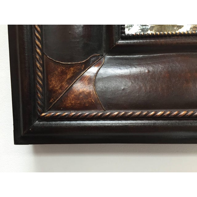 Pair of elegant dark brown leather wrapped mirror in Portuguese, Spanish Colonial style. Bevelled mirror. Very nice...